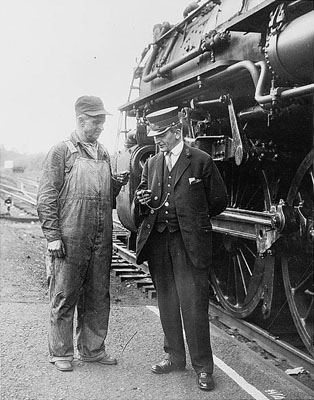 Conductor and Engineer compare time circa 1930, U.S. Library of Congress collection