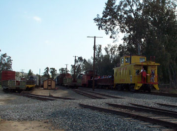 Visitor freight train passes the pie yard (Richard Boehle photo)